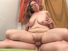 Busty and cuddly mommy riding her gardener's mighty cock