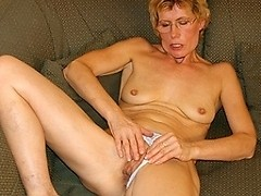 Horny blonde housewife and her toy