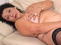 This horny mama loves to get wet on her couch