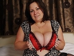 British housewife loves playing with her huge tits