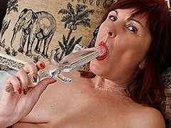 Sexy mature housewife plays with her favorite toys