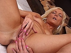 Horny blonde MILF gets her pussy wet