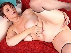 Naughty housewife getting wet on the couch