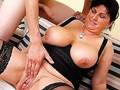 Big breasted squirting mature slut takes on two cocks