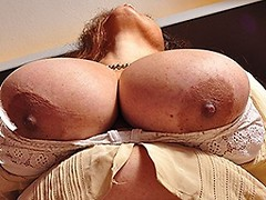 Huge breasted Latin mature Bra buster gets wet