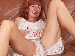 Horny British mom playing on her couch
