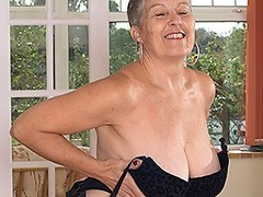 Naughty big breasted British housewife playing with herself