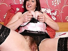 Hairy British mom showing off her nice tits and masturbating