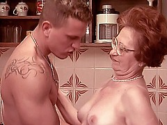 Mature lady Sabrina wears her reading glasses while getting hardcore fucked in the kitchen