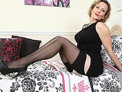 Classy British housewife showing off her goods