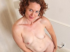Horny American mom playing with her shaved pussy
