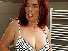 Horny redhead housewife getting herself off