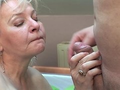 Kinky granny gets mouthfuls of hard young cock