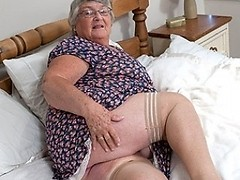 This granny loves to get wet herself
